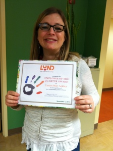Laura May at New Horizons with her Employee of the Quarter Certificate