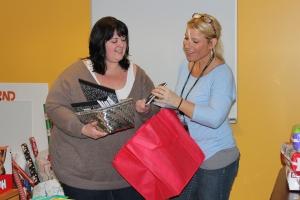 Staff members choosing gifts.