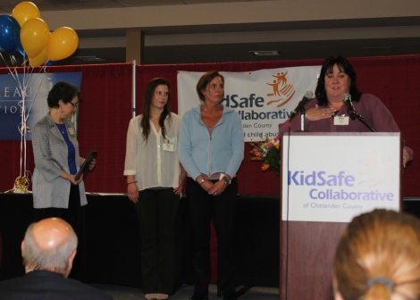 Kim Coe introduces Elsa (center in white) with Judy Harvey, Childcare Coordinator at Lund.  Sally Borden of KidSafe Collaborative listens from the far left.