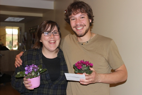 Lund's preschool teachers Ginny Prentiss and Colin Cope with their flowers of appreciation