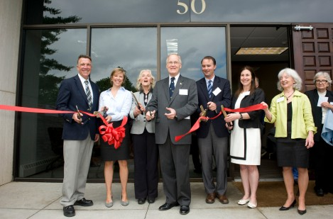 The leadership of the 50 Joy Drive Capital Campaign cut the ribbon and officially dedicate the building.