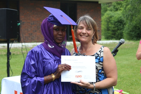 Graduation Day for one hard working student, seen here with NHEP teacher Kathy Rossman.