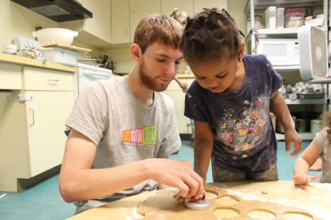 Kent and his helper work on cutting out the doughnut shapes.  Another friend worked on the holes.