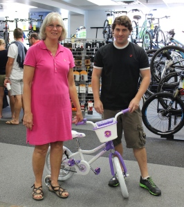 Barb with J.P. of North Star Sports with the sweetest little purple bike.