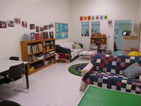 The Kids-A-Part visiting room at CRCF features bookshelves and cosy places to read.