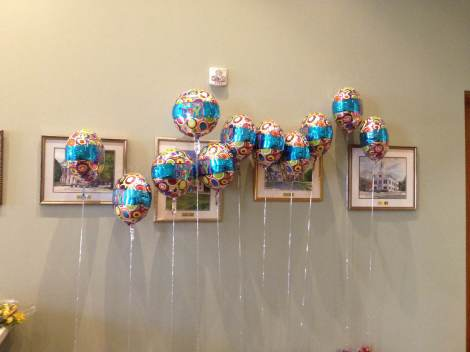 Helium balloons wait for every child adopted today. Celebrate!